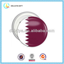 The Qatar flag tin badge for national day