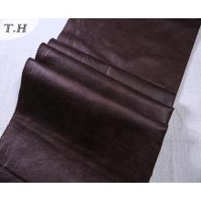 Las telas de tapicería de gamuza sintética oscura
