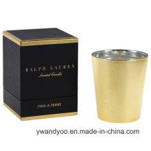 Vela perfumada de vidro dourado com caixa preta