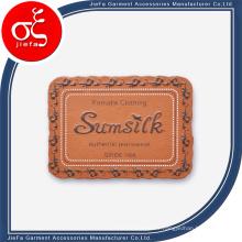 Étiquette en cuir faite sur commande de logo d'impression