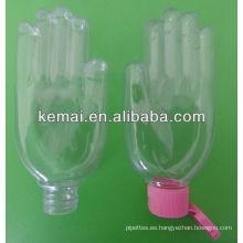 Botella plástica de la mano