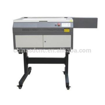 Precio barato de la máquina de grabado en la acción del laser del CO2