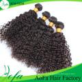 Extension de cheveux humains Remy de cheveux bouclés mongols vierges de 100% non transformés