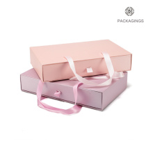 Pink cardboard sliding gift box with handle