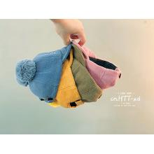 Bonnet en laine polaire boules de fourrure bébé