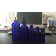 Hochwertige blaue Glasfläschchen mit Pipette für kosmetische Verpackung