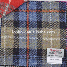 Blue and grey check with orange overcheck Harris tweed wool fabric