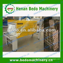 PE film heat shrink wrapping machine for wood briquettes 008613592516014