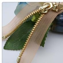 10 inch semilucent fringe brass zipper