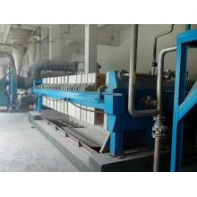 Plate and frame vacuum sludge dewatering press