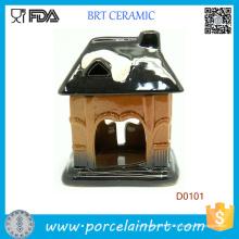 Brûleur à huile en céramique de forme de maison de pot