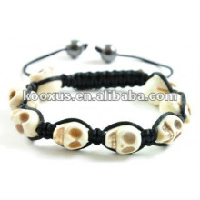 Cream 8 skull shamballa bracelet