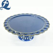 Plato de fruta de dobladillo de patas altas de cerámica azul personalizado de fábrica de China