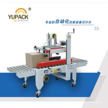 Machine de scellage de carton automatique à chargement lourd avec entraînement supérieur, inférieur et latéral (FXJ-6050B / 8060B)