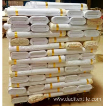 WHITE FABRIC ROLL PACKING ON WOODEN BOARD