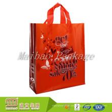El supermercado material amistoso económico al por mayor barato lleva el embalaje de los bolsos de compras plásticos reutilizables con los logotipos de encargo
