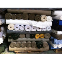 Una acción de la tela de algodón del grado