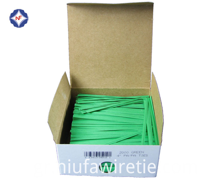 green paper twist tie in box