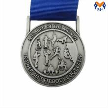 Silver embossed sport member medal