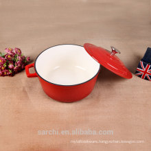 Red enamelware die cast pot