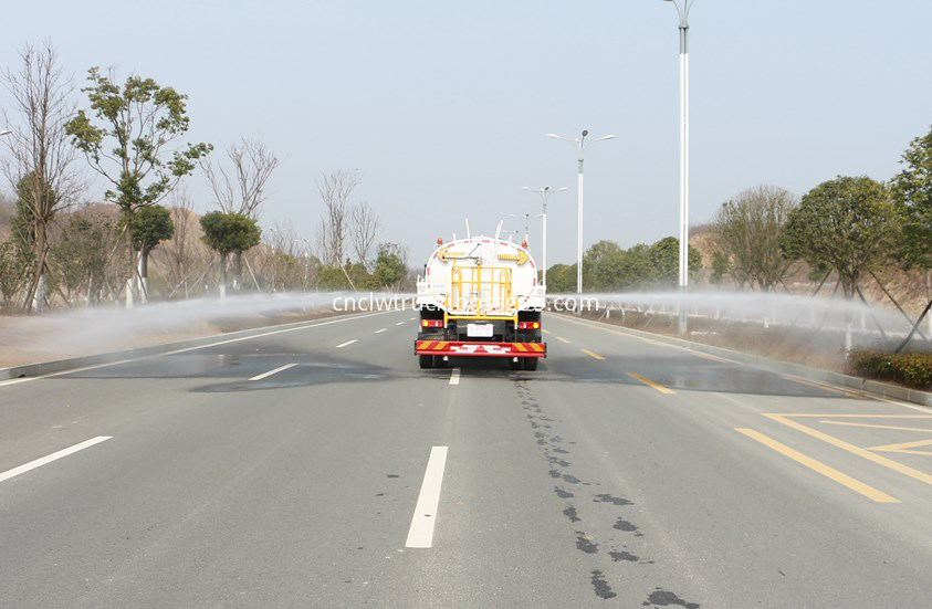 water spray truck in action 3