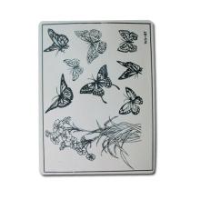 Peaux de pratique de tatouage avec papillon