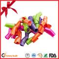 Des arcs de curling de Noël nouvellement colorés de qualité supérieure pour la vente