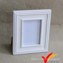 Marco de madera de fotos blanco con soporte