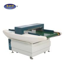 High sensitivity needle metal detector with conveyor belt