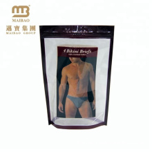 L'affichage de la publicité tient le sac d'emballage en plastique de ziplock de conception faite sur commande de poche de bikini avec le logo