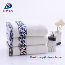 Отель махровое полотенце с вышивкой логотипа