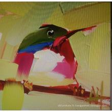 Peinture à l'oiseau à la main