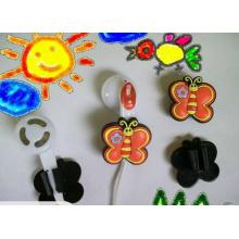 Encantos lindos y de moda de los auriculares suaves del PVC