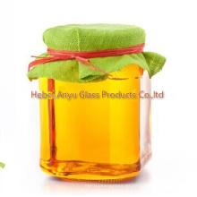 Botella de almacenamiento de vidrio / Hexagonal Jam Jar Jarra de miel de vidrio hexagonal con tapa de aluminio