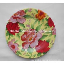 Runde Teller mit Blumenabziehbild