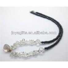 Perle de cristal naturel avec pendentif en pierre