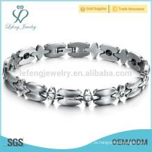 La cruz vendedora caliente conecta la pulsera, pulsera del acero inoxidable de las señoras