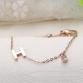 Bracelet initial fait sur commande d'alphabet de lettre en or rose de cristal