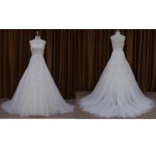 Vestido de novia sin tirantes con cuentas y organza