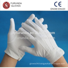 100% cotton inspection gloves with three lines on back and button on cuff