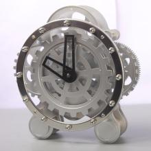 Stainless Gear Beside White Table Clocks