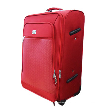 Equipaje rojo giratorio extensible para viajes.