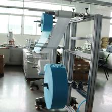 Автоматическая упаковочная машина для масок на складе