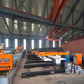 Automatic roof panel stacker for roll forming machine