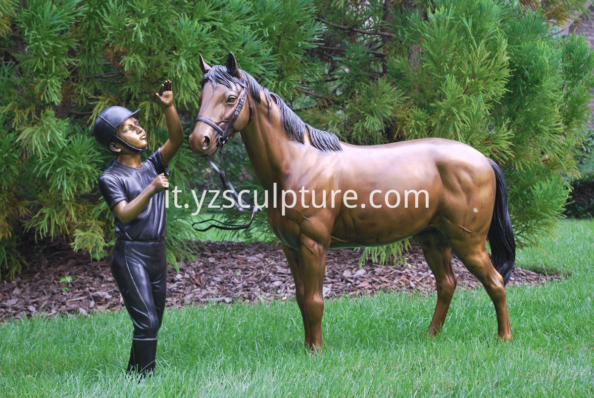 brass man and horse statue