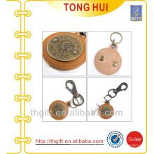 Round metal logo leather keychains