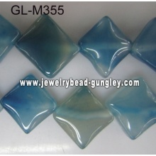 Across corners square agate bead-blue