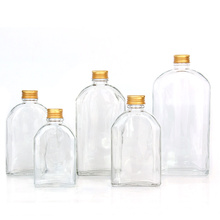 empty flat shaped clear color 100ml 200ml 250ml 350ml 500ml wine glass bottle with screw gold aluminum lid