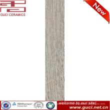 foshan precio de fábrica gris madera textura de madera acabado de baldosas de cerámica