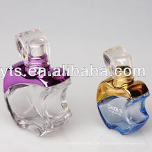 botella de perfume en forma de manzana